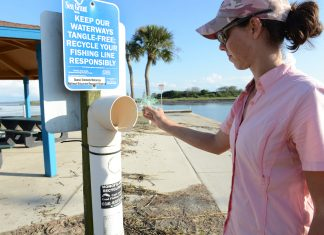 Melissa Crouch recycles her used fishing line in a monofilament recycling bin. Find one near you at MRRP.MyFWC.com. Photo by Tim Donovan/FWC