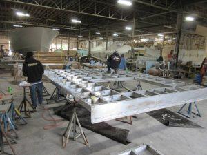JB 67- Aluminum framework for salon floor laid up and being welded together