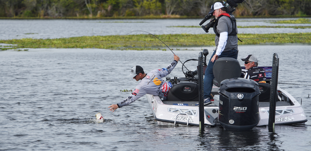 Jordan Lee reaches for one of his third-period fish. Photo by Garrick Dixon