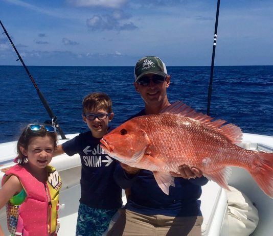 (L-R) Summer, Sawyer and Capt. Bonner Herring with a nice American red snapper that was released right after this picture was taken.